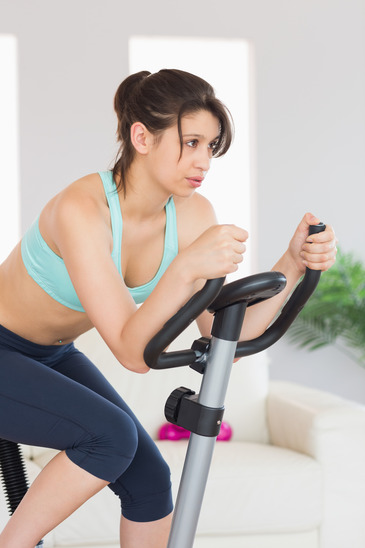 Bored looking woman on an exercise bike