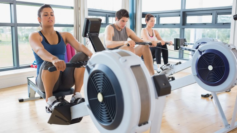 3 People Using A Rowing Machine