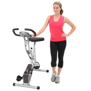 Woman With Exerpeutic Folding Upright Bike