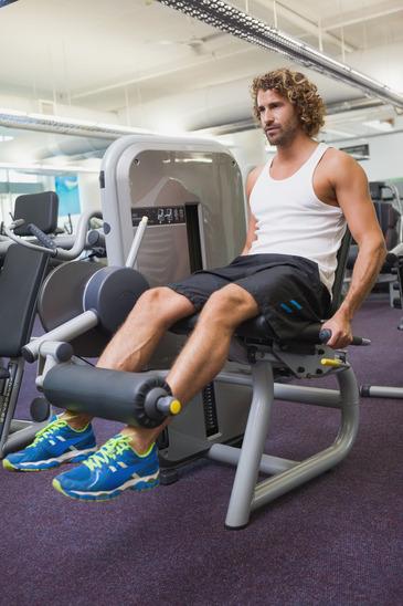 Man Doing A Leg Workout At The Gym