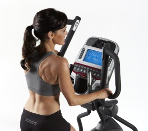 Woman Using E95 Elliptical Trainer