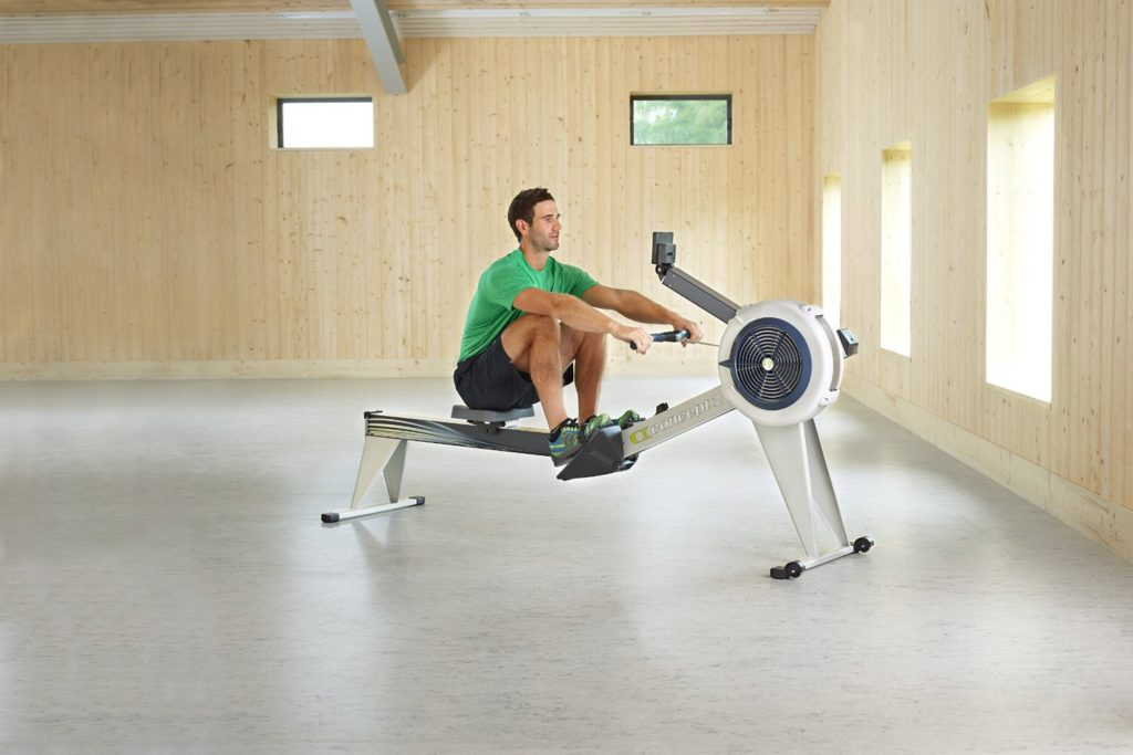 Man Using Concept 2 Model E Rowing Machine