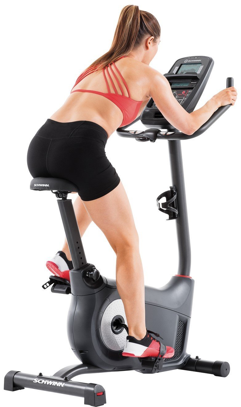 Woman Using Schwinn 130 Exercise Bike