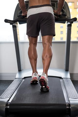 Fit Man Running On Treadmill