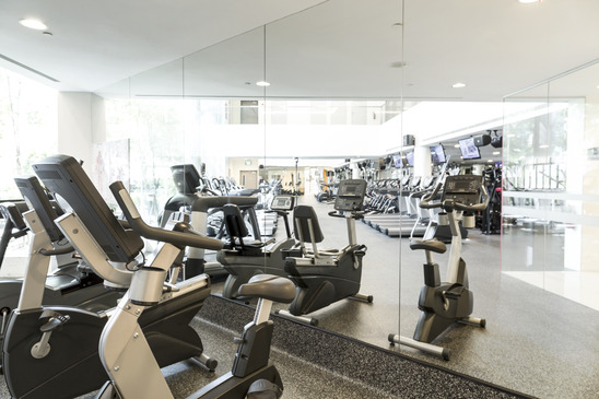 An interior shot of a club gym with all the exercise equipment