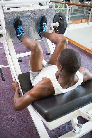 Man Using Leg Press Machine