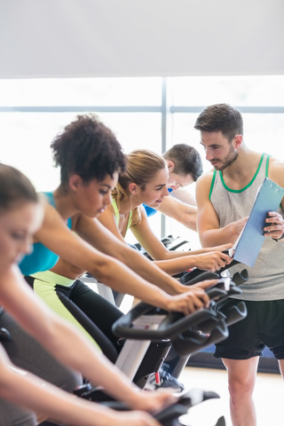 Instructor Giving Advice In A Group Cycling Class