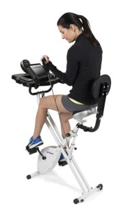 Woman Using Resistance Bands On FitDesk Bike