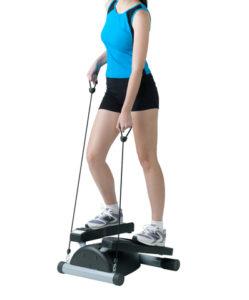 woman using stepper machine