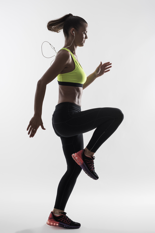 Woman doing the high knees exercise.
